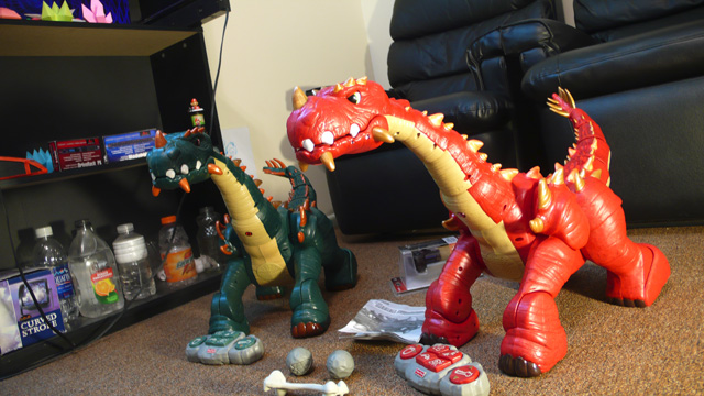 Two 'Spike the Ultra Dinosaur' toys in Admiral Potato's front room