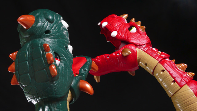 An epic battle between two 3 foot tall toy dinosaurs! Oh, the carnage! Oh, the violence!